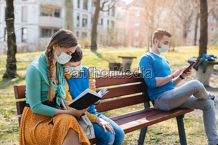 people sitting on park bench in