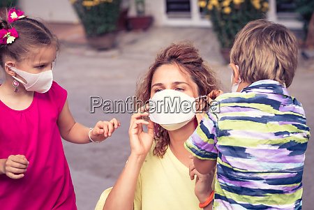 family wearing facial disposable mask coronavirus