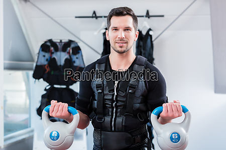 strong man in ems gym doing