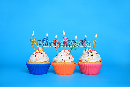 birthday cupcakes with candles that say
