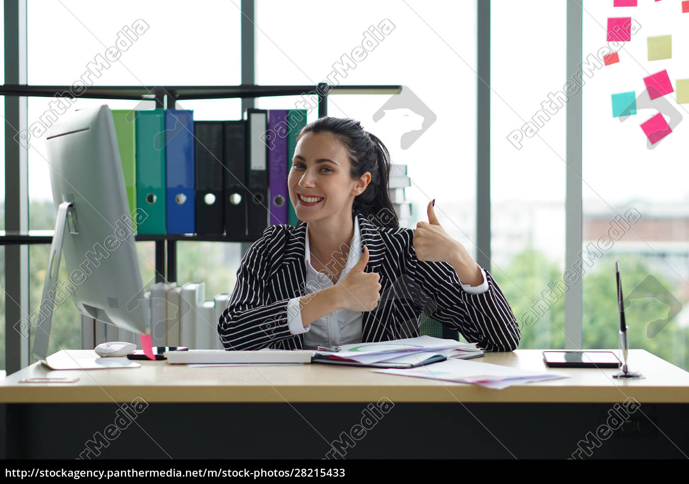 a, businesswoman, looks, very, happy, after - 28215433