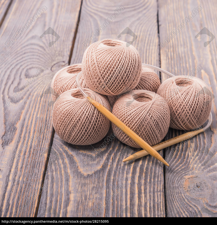 balls, of, yarn, and, knitting, needles - 28215095