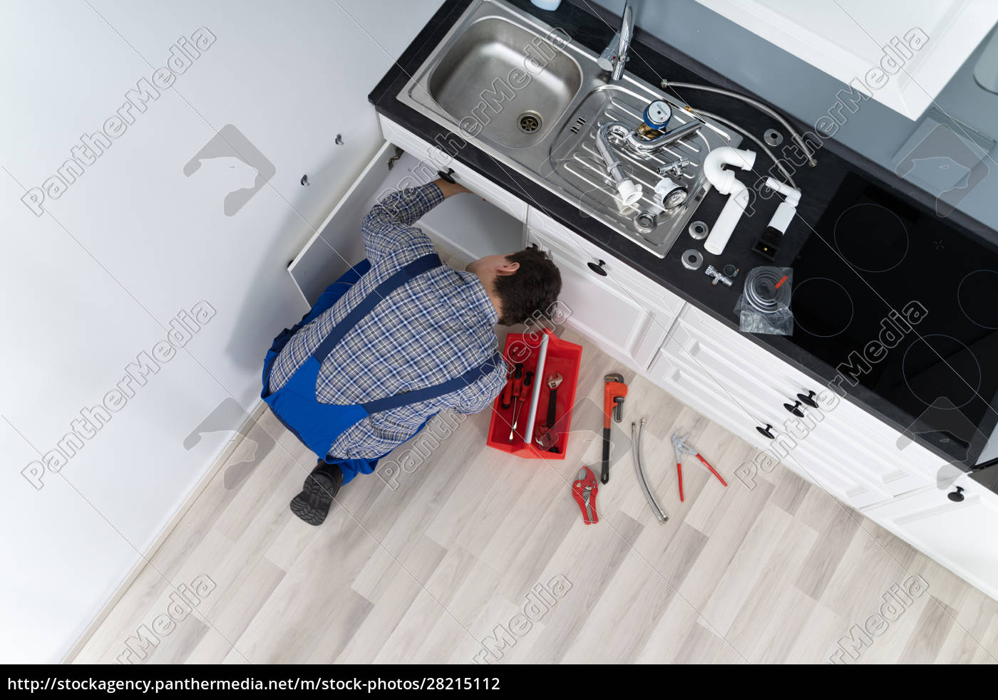plumber, examining, kitchen, pipes - 28215112