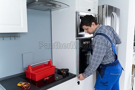 repairman, repairing, oven - 28215116