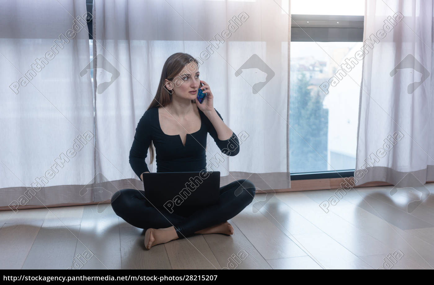 self-quarantined, woman, with, phone, and, laptop - 28215207
