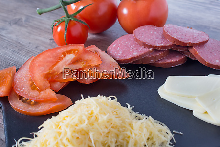 sliced, tomatoes, , sausage, and, cheese, are - 28215087