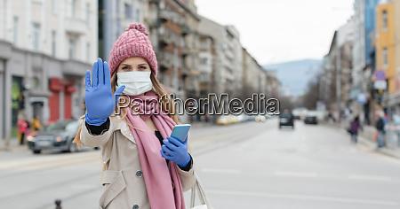 woman, in, empty, lockdown, city, giving - 28215200