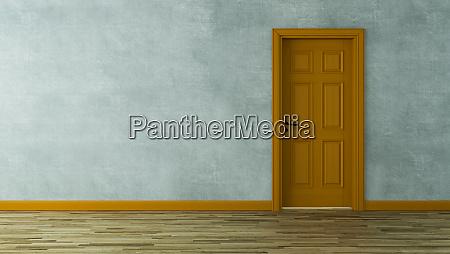 orange, wooden, door, with, concrete, wall - 28216086