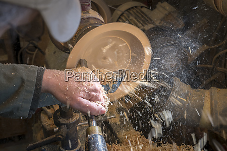 making a wooden bowl on a