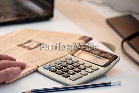 calculator, and, finance, newspaper., coronavirus, concept. - 28217914