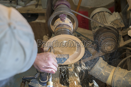 making, a, wooden, bowl, on, a - 28217613