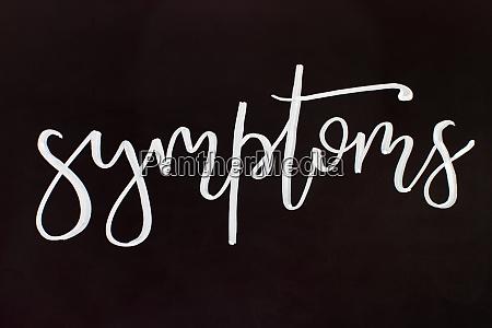 chalk inscription symptoms on a black