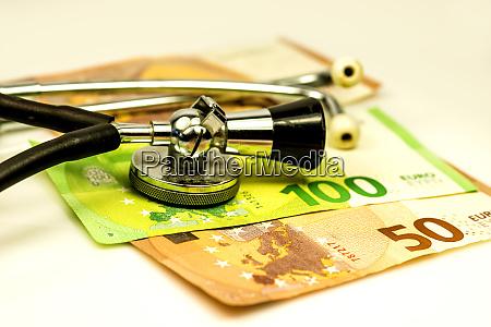 stethoscope with euro bills