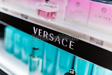 bottles of perfume by versace on