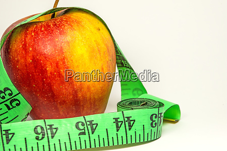 apple with a tape measure