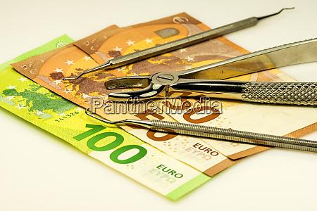 dental forceps with euro bills