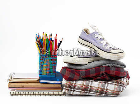 stack of folded clothes sports sneakers