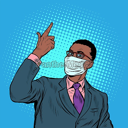 african businessman in a medical mask