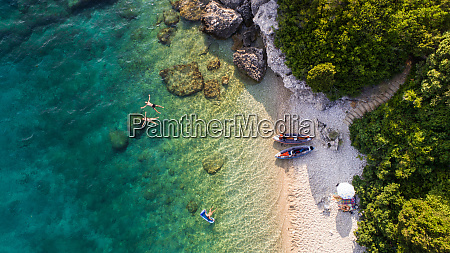 aerial view of kayakers swimming near