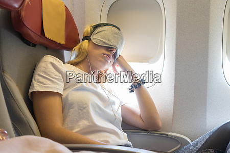 tired blonde casual caucasian lady napping