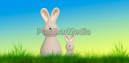 easter bunnys stand on a meadow