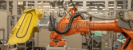robot arms in the factory performs