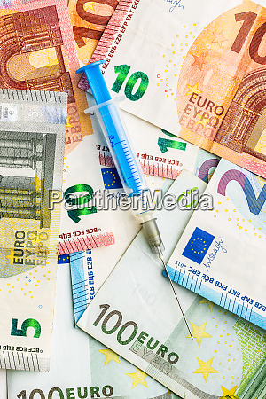 syringe and euro money healthcare concept