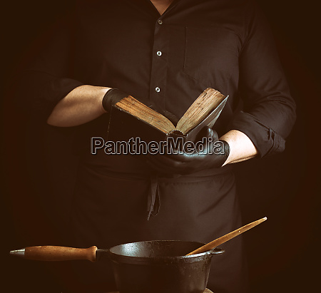 male cook in a black uniform