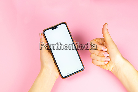 woman holding a phone in one