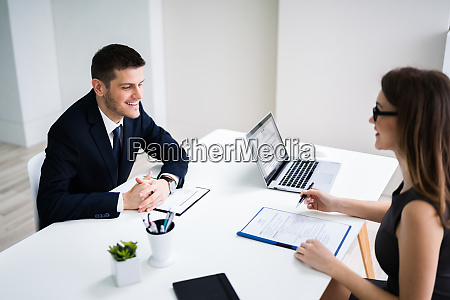 man in interview in office