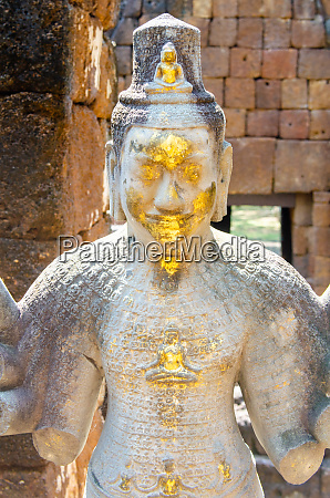 gilded deity in prasat mueang sing
