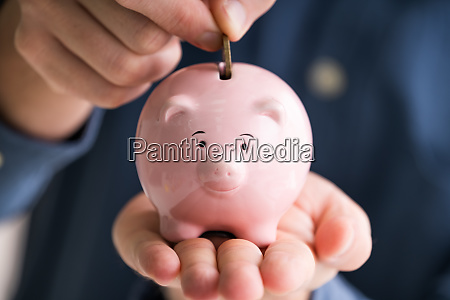 close up of man inserting coin