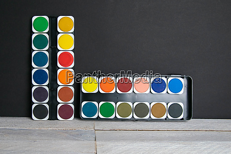 colorful paints stand on a wooden