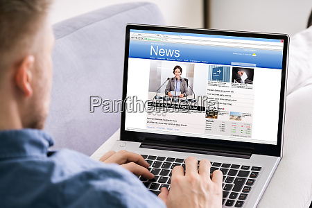 man reading news website