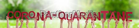 people hands holding word corona quarantaene