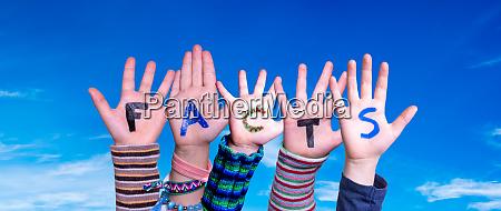 children hands building word facts blue