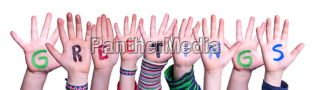 children hands building word greetings isolated