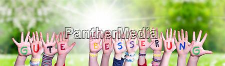 children hands building word gute besserung