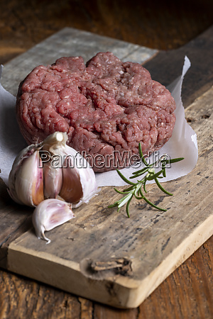 raw minced meat on dark wood