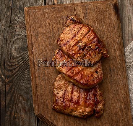 fried juicy pork steak on a