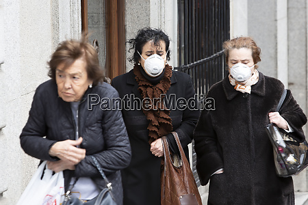 women wearing protective face masks to