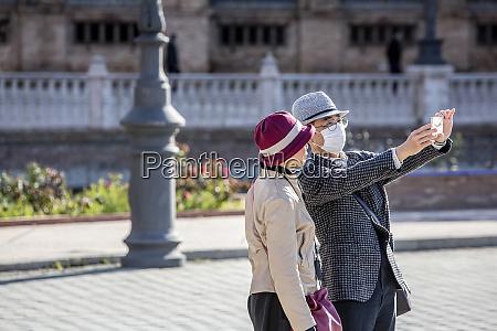 couple in seviille spain taking selfie