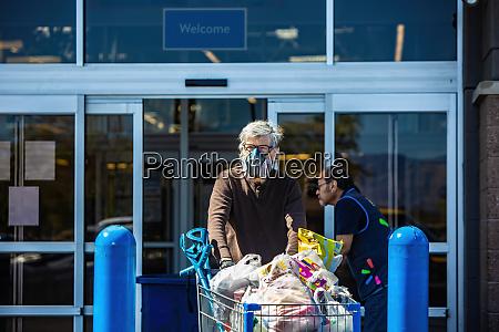 man wearing ventilator mask to leaving