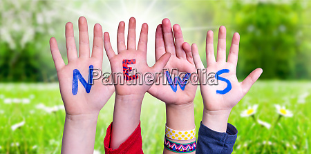 children hands building word news grass