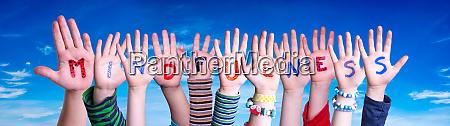 children hands building word mindfulness blue