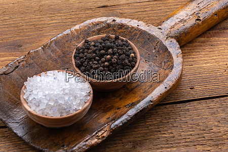 black whole peppercorns and blue crystal