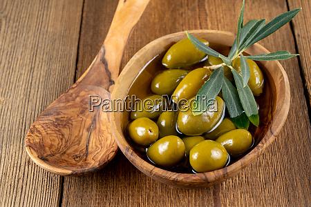 green olives in olive oil in