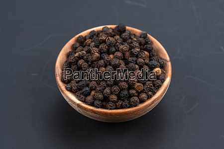 whole black peppercorns in a small