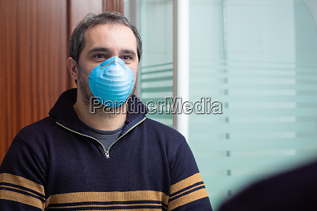 worried man with medical mask looking