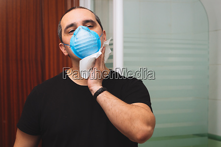 40s man with medical mask wipes